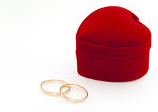 Two rings and red box. Two rings and heart shaped red box Royalty Free Stock Image
