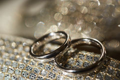 Two rings on the shiny background.  Stock Photography