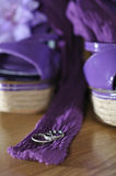 Two rings with shoes in background Stock Photo