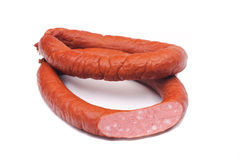 Two rings of  smoked sousages with section Stock Photos