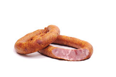Two rings of  smoked sousages with section Stock Photography