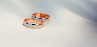Two rings in white background. Pair of wedding rings. Very shallow depth of field Stock Images