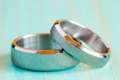 Two  rings on the  wooden surface Stock Photo