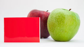 Two ripe apples and empty red card Stock Photos