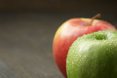 Two ripe apples on wood table Stock Photo