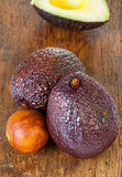 Two ripe avocados and avocado core Stock Images