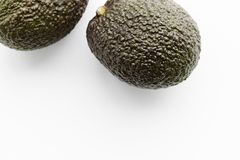 Two ripe avocados Haas on a white background stock image