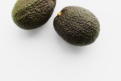 Two ripe avocados Haas royalty free stock images