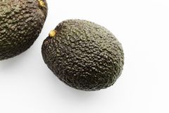 Two ripe avocados Haas on a white background royalty free stock photos