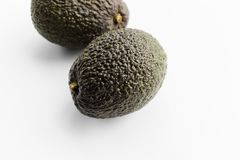 Two ripe avocados Haas on a white background royalty free stock photography