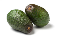 Two ripe avocados isolated Royalty Free Stock Photo