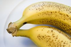 Two ripe bananas on white plate Royalty Free Stock Photo