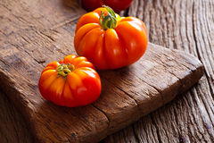Two ripe beef tomatoes on cutting board Stock Photo