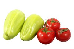 Two ripe bell pepper and three red tomatoes isolated on a white background. Two ripe bell pepper also known as sweet pepper or capsicum and three red tomatoes stock image