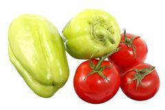 Two ripe bell pepper and three red tomatoes isolated on a white background. Two ripe bell pepper also known as sweet pepper or capsicum and three red tomatoes stock photos