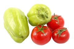 Two ripe bell pepper and three red tomatoes isolated on a white background. Two ripe bell pepper also known as sweet pepper or capsicum and three red tomatoes royalty free stock images