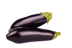 Two ripe eggplants on white background. Two ripe eggplants isolated on white background Stock Photos