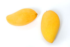 Two ripe golden mangoes on white Stock Images