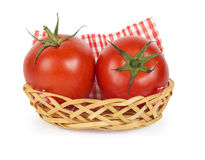 Two ripe juicy tomatoes in a basket Royalty Free Stock Photos