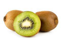 Two ripe kiwis and a half close-up on a white. Isolated. stock photography
