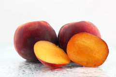 Two ripe peach on a white background Royalty Free Stock Images