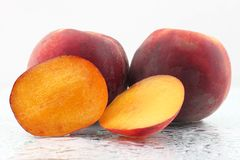 Two ripe peach on a white background. Useful vitamin food of fruit royalty free stock images