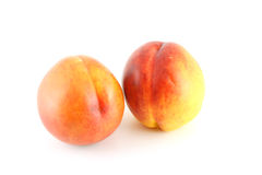 Two ripe peaches. Over white Stock Photography