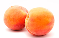 Two ripe peaches isolated on a white Stock Image