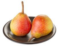 Two ripe pears on a black plate Stock Images