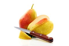 Two ripe pears and knife. Royalty Free Stock Image