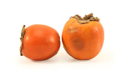 Two ripe persimmon fruit Royalty Free Stock Images