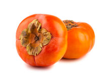 Two ripe persimmon fruits Royalty Free Stock Photography