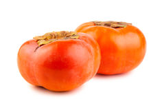 Two ripe persimmons on a white background Royalty Free Stock Images