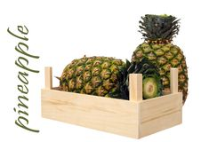 Two ripe pineapples in crate Royalty Free Stock Photos