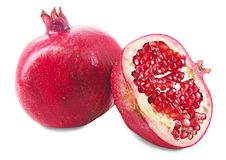 Two ripe pomegranates on white background. Two ripe pomegranates isolated on white background stock photo