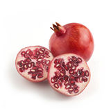 Two ripe pomegranates. one whole one cut in halve showing his in Stock Image