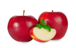 Two ripe red apple with a slice. On white Royalty Free Stock Photos