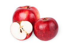 Two ripe red apples and half of apple.  on a white backg Stock Photo