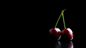 Two ripe red cherries Stock Photo
