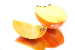 Two ripe slices of a persimmon Royalty Free Stock Image