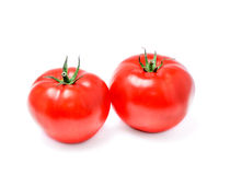 Two ripe tomatoes closeup on a white Royalty Free Stock Photos