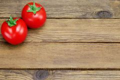Two Ripe Tomatoes On Rustic Wood Background Royalty Free Stock Image