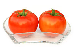 Two ripe tomatoes on a transparent bowl Stock Photography