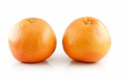 Two Ripe Wet Grapefruits with Leaves Isolated Stock Image