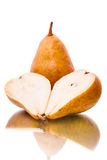Pear halves. Two ripe yellow pears on white background stock images