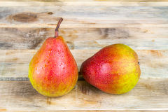 Two ripe yellow and red pears on rustic wooden background Stock Photography