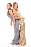 Two rival girls in gold and silver dress Royalty Free Stock Image