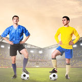 Two rival soccer or football players. Are standing on stadium Royalty Free Stock Photo