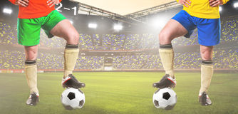 Two rival soccer or football players Royalty Free Stock Image