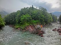 Two Rivers. Picture taken in a way that it can be seen the merging of two rivers. Republic of Adygea stock photo